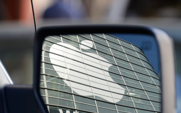 Apple logo in a car's mirror